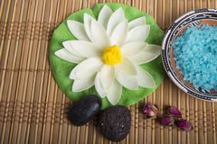 Wellness set with natural rosebuds and stones. Royalty Free Stock Photo