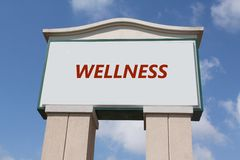 Wellness Sign. The word 'wellness' on a sign against a blue sky Stock Photo