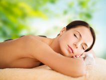 Beautiful woman having hot stone therapy at spa Stock Photography