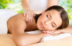 Close up of beautiful woman having massage at spa royalty free stock image