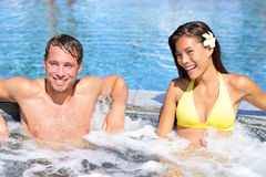 Wellness Spa - couple relaxing in hot tub whirlpool stock photos