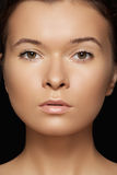 Wellness, spa and tan. Model face with purity skin. Make-up, spa & cosmetics. Portrait of beautiful tan woman model face with clean skin, pure complexion on Royalty Free Stock Photo