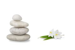 Wellness still life, jasmine with pebbles stacked Royalty Free Stock Image