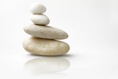 Wellness still life, tower of pebbles Stock Photos