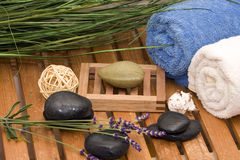 Wellness stuff. Wellness decoration in my parents bathroom with towel and plant Royalty Free Stock Photo