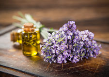 Wellness treatments with lavender flowers on wooden table. Stock Photo