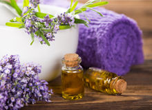 Wellness treatments with lavender flowers on wooden table. Stock Photography