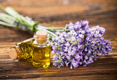 Wellness treatments with lavender flowers on wooden table. Royalty Free Stock Photos