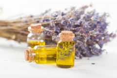Wellness treatments with lavender flowers on wooden table. Royalty Free Stock Photo