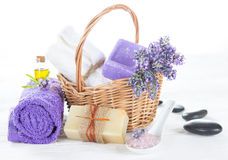 Wellness treatments with lavender flowers on wooden table. Stock Image