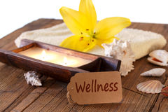 Wellness voucher. With candles and shells Stock Photography