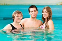 Wellness - woman and couple in swimming pool Royalty Free Stock Images