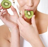 Wellness woman eating kiwi. Healthy lifestyle Stock Photos