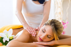 Wellness - woman getting body massage in Spa. Wellness - women receiving body or back massage in spa Royalty Free Stock Photos