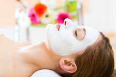 Wellness - woman getting face mask in spa. Wellness - woman receiving facial mask in spa for clean and moist skin Royalty Free Stock Image