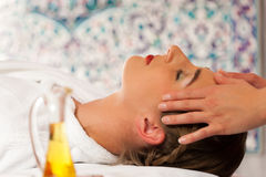 Wellness - woman getting head massage in Spa Stock Images