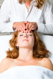 Wellness - woman getting head massage in Spa. Wellness - woman getting massage in Spa, it is a massage for the head or face Royalty Free Stock Photos