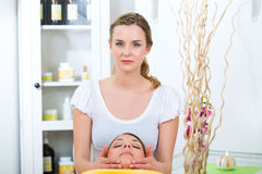 Wellness - woman getting head massage in Spa. Wellness - woman receiving head or face massage in spa royalty free stock photos