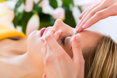 Wellness - woman getting head massage in Spa. Wellness - women receiving head or face massage in spa stock photo