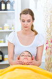 Wellness - woman getting head massage in Spa. Wellness - women receiving head or face massage in spa stock photography