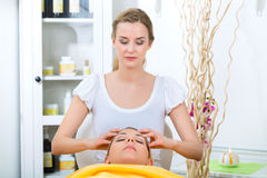 Wellness - woman getting head massage in Spa. Wellness - women receiving head or face massage in spa royalty free stock photography