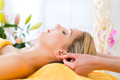 Wellness - woman getting head massage in Spa. Wellness - women receiving head or face massage in spa stock image