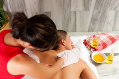 Wellness - woman getting massage in Spa. Wellness - women getting massage in Spa; the therapist is using a glove royalty free stock image