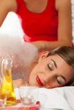 Wellness - woman getting massage in Spa Stock Images