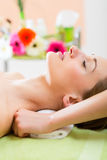 Wellness - woman getting shoulder massage in Spa. Wellness - woman receiving neck or shoulder massage in spa Royalty Free Stock Images
