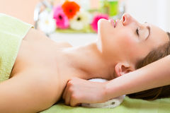 Wellness - woman getting shoulder massage in Spa. Wellness - woman receiving neck or shoulder massage in spa stock images