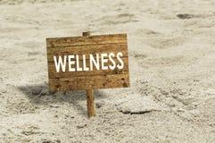 Wellness wooden sign on a beach. Stock Photo