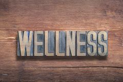 Wellness word wood. Wellness word combined on vintage varnished wooden surface stock photo