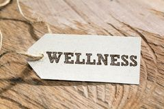 Wellness. Word written on a Looking card Royalty Free Stock Photos