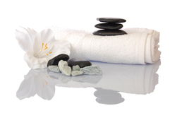 Wellness zen and spa. Still life with flower towel and pebbles isolated on white Stock Images