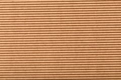 Wellpapp för inpackning horisontallinjer för abstrakt bakgrund med krabba linjer av beige färg arkivfoton