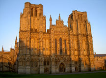 Wells Cathedral facade at sunset. Wells Cathedral in south west England, beautifully lit by the setting sun stock image