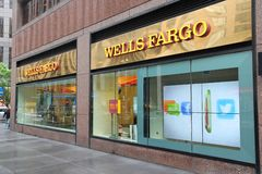 Wells Fargo Bank. NEW YORK, USA - JUNE 10, 2013: People walk by Wells Fargo Bank branch in New York. Wells Fargo was the 23rd largest company in the United Stock Image
