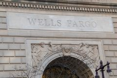 Wells Fargo name chiseled into the stone on top of the front entrance to this building in Philadelphia. Philadelphia, Pennsylvania - February 5, 2019: Wells stock images