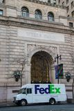 Wells Fargo name chiseled into the stone on top of the front entrance to this building in Philadelphia. There is a FedEx truck on royalty free stock photography