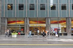 Wells Fargo New York. NEW YORK, USA - JULY 1, 2013: People walk by Wells Fargo Bank branch on in New York. Wells Fargo was the 23rd largest company in the United Stock Image