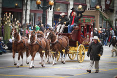 Wells Fargo Stagecoach. Chicago, Illinois - Image of the Wells Fargo Stagecoach  on a parade float in the annual Thanksgiving Parade Royalty Free Stock Images
