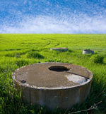 Wells on green land Royalty Free Stock Photography