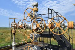 Well for oil and gas production. Oil well wellhead equipment. Oil production. Wells in the Kuban. Extraction of hydrocarbons. Wells in the Kuban. Extraction of Royalty Free Stock Photo