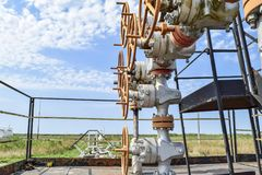 Well for oil and gas production. Oil well wellhead equipment. Oil production. Wells in the Kuban. Extraction of hydrocarbons. Wells in the Kuban. Extraction of Stock Image