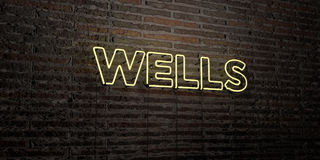WELLS -Realistic Neon Sign on Brick Wall background - 3D rendered royalty free stock image. Can be used for online banner ads and direct mailers Stock Photos
