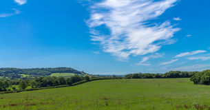 Wells to Glastonbury. View from Wells towards Glastonbury Tor on a summer day Royalty Free Stock Image