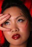 Wellustige Aziatische vingers op gezicht royalty-vrije stock foto's