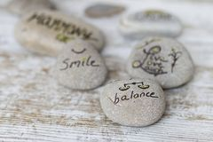 Welness concepts on stones. Stones with some words writen on them royalty free stock image