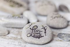 Welness concepts on stones. Stones with some words writen on them stock images