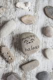 Welness concepts on stones. Stones with some words writen on them royalty free stock images